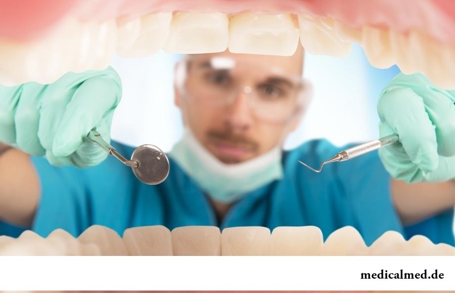 Налет на зубах: виды и причины